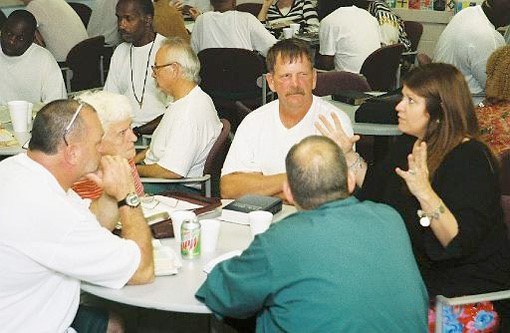 Photo of small groups at a Yokefellow Prison Ministry meeting